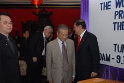 Escorting Dr Mahathir onto the stage
