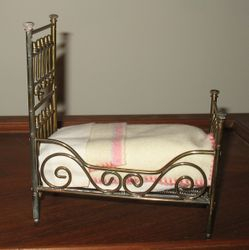 Brass bed with high head from the side