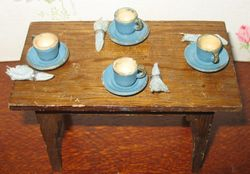 Blue wooden cups and saucers