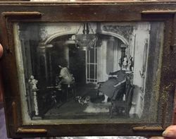 Framed photo of the lower right rooms in the house