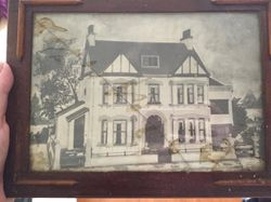 Framed photo of the front of the house