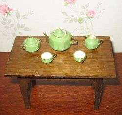 Green wooden tea set, missing the saucers
