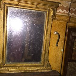 Mirror above a fireplace, left ground floor room