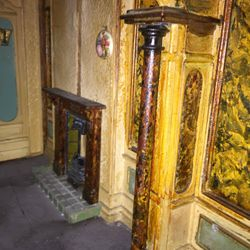 Right ground floor marbled walls and fireplace