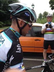 Cav holding two bikes whilst mechanic adjusts