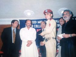 Mir Iqbal getting prize in All Sindh Inter Colleges Tri-Lingual Speech