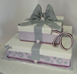 Elegant gift box themed birthday cake with jewelry.
