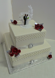 Two tier wedding cake with red fondant roses