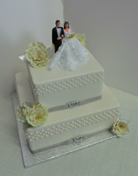Two tier wedding cake with white roses