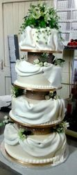 4tier Wedding cake with wide drapes