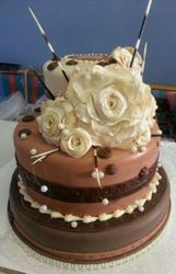 African themed wedding cake with fondant roses and porky pine