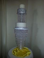 3 Tier Silver on white wedding cake on crystal stand