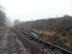 Ballast piled on side railway