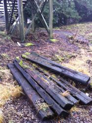 Sleepers piled by station bridge