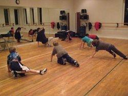 Meka teaching class at the dance studio