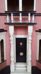 Close up of door, pillars and balcony