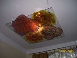 glass hung from ceiling under light fixture