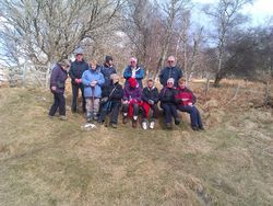 Happy ramblers half way to Viewpoint 3 and a howling gale at Grantown!
