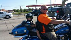 Woody giving his son a ride on the bike