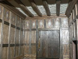 Oak panelling and a pargetted ceiling
