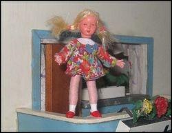 Girl balancing on balcony railing