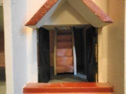 Double front door open, showing stairs