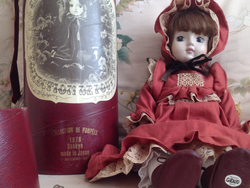 Showing doll and box