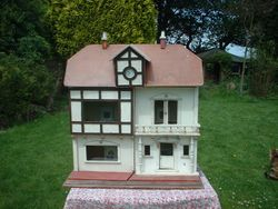 """No 34,""""The Clock House"""", 1909-10. 30 inches [76 cm] high. Other dimensions not known."""