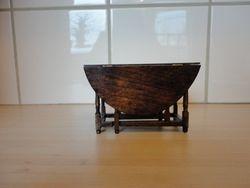 Escutcheon table, closed, side view