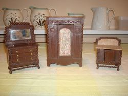 Three pieces of bedroom furniture