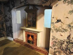 Fireplace in lower right room (detail)