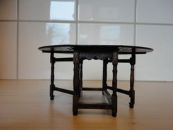 Escutcheon table, fully extended, side view