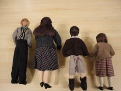The four Pevensie children - back view