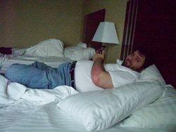 John Koch on the bed