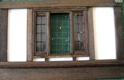 The window is built onto the wall in stripwood