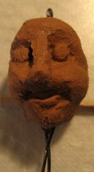 First head in an air-drying clay looking clay
