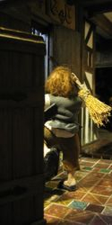 And the LED behind the door gives a view of the back of the boy with the broom