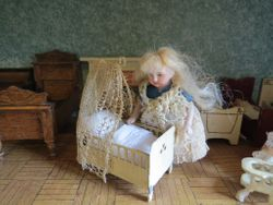 Tin Cradle & All Bisque German Doll