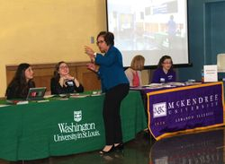 Mrs. Sandra Knight, Board Member of HAC talks with Washington University admission representatives.