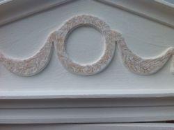 Hand decorated pediment swag