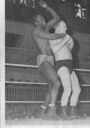 Alf Cadman on the receiving end from Massambula