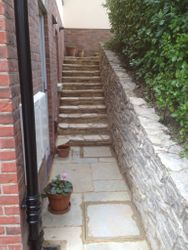 Purbeck walling with Indian sandstone paving