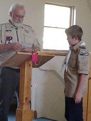 Tim awarding Isaac his rank