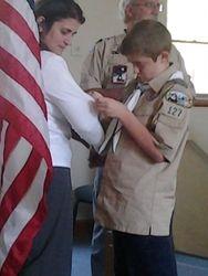 Isaac giving his mom Christina her parent pin