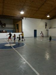 The kids enjoying some dodgeball in the gym between projects.