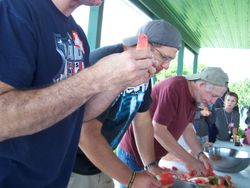 The men chow down on watermelon