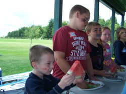 Kids get ready to eat watermelon