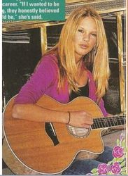 With her guitar at 14