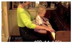 Playing piano with her grandma