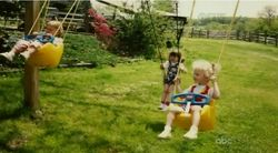 Taylor on a swing